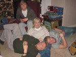 Aunt Cathy and her boys. Zach in the red chair, Cathy in the middle, Larry in the green and Blake in the grey.