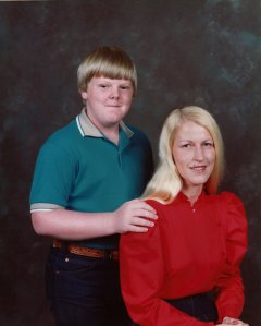 Just ignore the fat kid with the stupid grinny smile, but see what I mean about Mama's hair? Why would you cover that up?